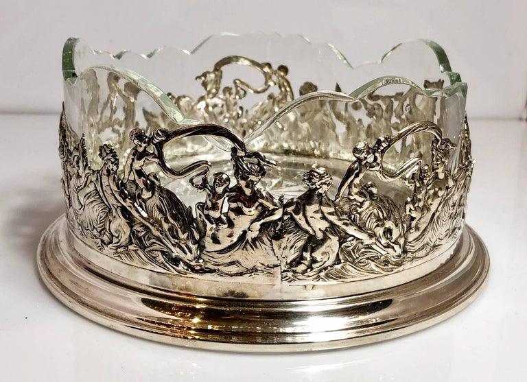 Antique Continental silver wine coaster with crystal liner, circa 1900-1910.