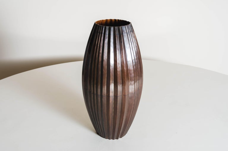 Barrel vase Antique copper Hand Repoussé Limited Edition  Repoussé is the traditional art of hand-hammering decorative relief onto sheet metal. The technique originated circa 800 BC between Asia and Europe and in Chinese historical context, it