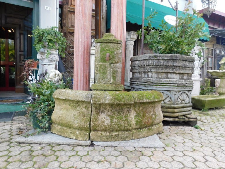 Ancient corner fountain in Burgundy stone, very beautiful and with a beautiful lived patina, perfect in an outdoor corner or garden decor, produced in the 1900 in Italy.