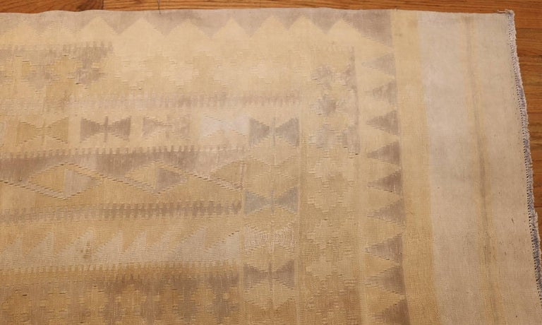 Antique Indian Dhurrie rug, country of origin: India, date circa early 20th century. Size: 9 ft 4 in x 16 ft 9 in (2.84 m x 5.11 m)  Woven in India, this antique Indian dhurrie rug is decorated with high-impact patterns rendered with an inventive