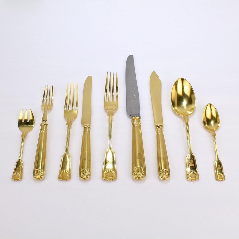 A very fine antique luncheon Mappin Plate flatware service by Mappin & Webb.  The pattern is a double fiddle-thread & shell variant. It is rare to find a set of their gold-plated flatware!  Each pieces bears an engraved family crest with a lion's