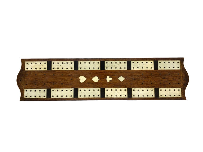 Antique cribbage board and box in mahogany with exotic inlays, English, circa 1880.