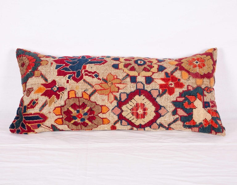 The rug used for this pillow is an early 20th century example and the entire background color of the rug was simply black but corroded throughout years and left a 3D effect on the surface.