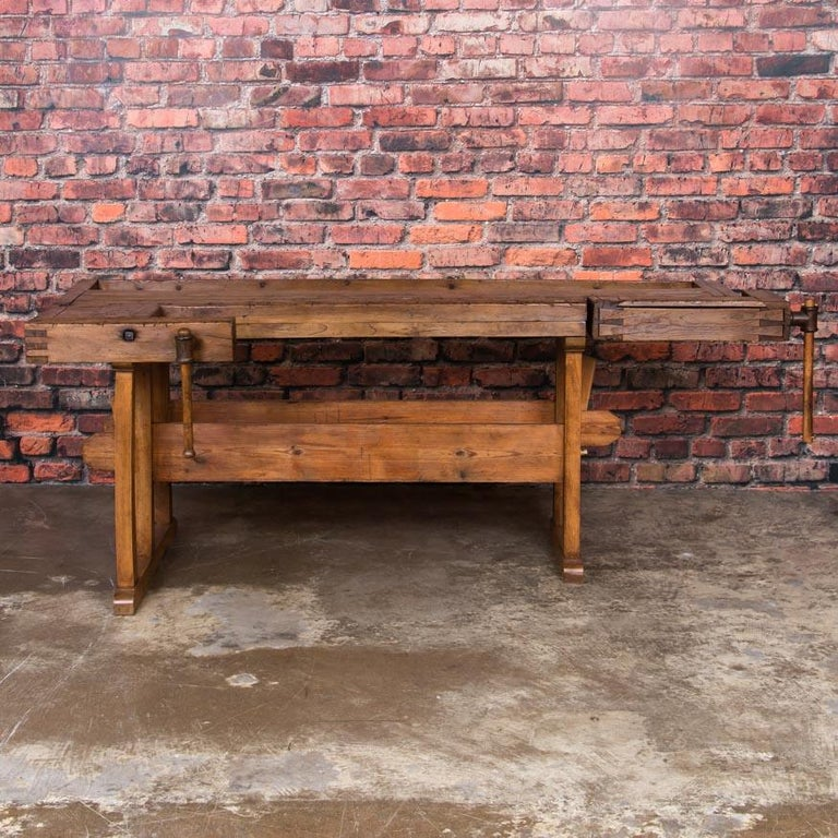 Beautiful antique Danish carpenters' workbench, bearing an incredible patina after years of traditional use. Please examine the close up photos to appreciate the depth of the patina. It has two wooden vices with wood handle and a recessed tray where