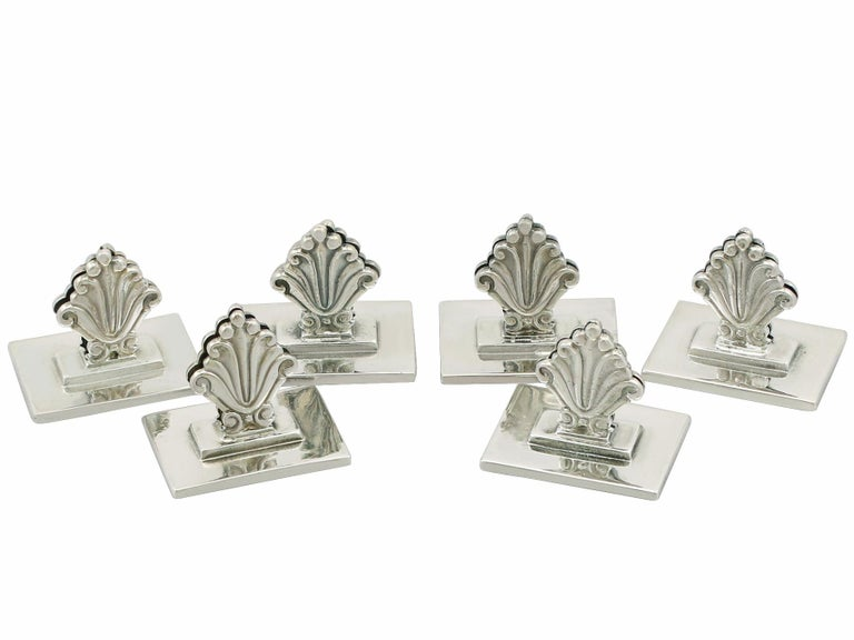 An exceptional, fine and impressive set of six antique Danish cast sterling silver menu / card holders made by Georg Jensen; an addition to our diverse dining silverware collection.