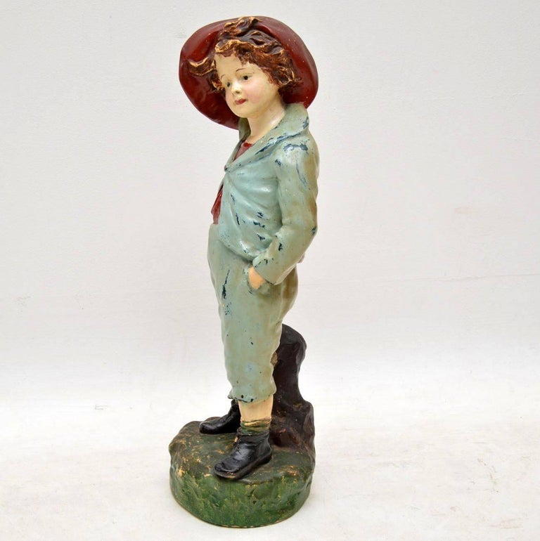 Large antique chalk ware figure of a boy in very good condition. I think he is dressed in French clothes & it looks fairly old. I'm not that familiar with this type of thing, so it's very hard for me to age. All I know, is that it's large, colourful