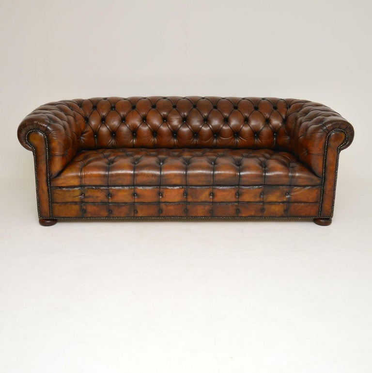 This is a very high quality antique deep buttoned leather Victorian style Chesterfield sofa and well above the average standard.  There are no splits, tears or holes and the leather has just been professionally cleaned and polished. It's deep