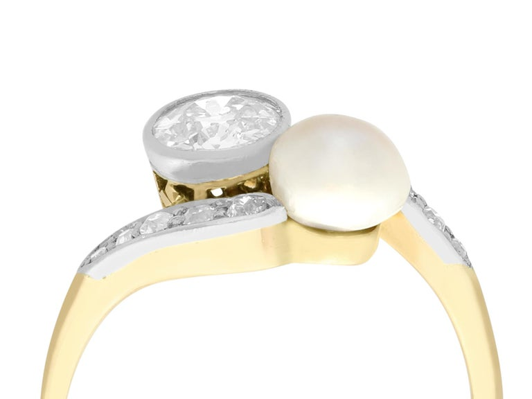 A stunning, fine and impressive antique 0.88 carat diamond and certified natural saltwater pearl, 14 karat yellow gold and platinum set dress / twist ring; part of our antique jewelry and estate jewelry collections  This stunning antique pearl and