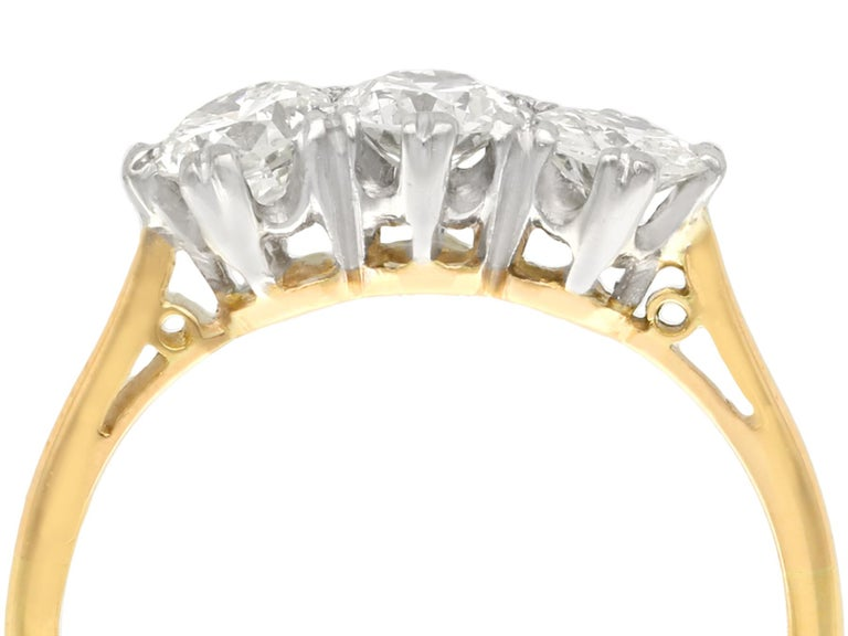 An impressive vintage 0.93 carat diamond and 18 karat yellow gold, 18 karat white gold set trilogy ring; part of our diverse antique jewelry and estate jewelry collections.  This fine and impressive gold diamond trilogy ring has been crafted in 18k
