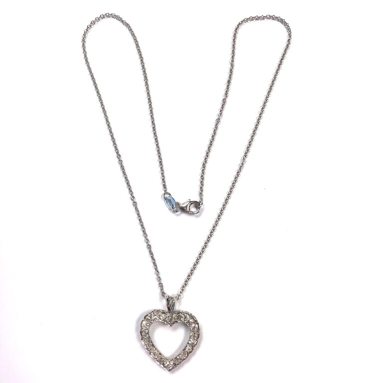 The pendant is crafted in 14K white gold and set with twenty old european and rose cut diamonds, supported by a sixteen inch rolo chain with lobster claw clasp. Approximate total diamond weight: 1.60ct. Clarity: SI1-I1, Color: