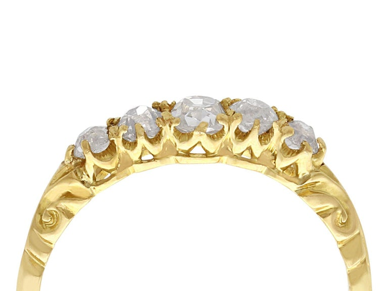 A fine and impressive antique 0.66 carat diamond and 18 karat yellow gold five stone ring; part of our diverse antique jewelry and estate jewelry collections  This fine and impressive antique five stone diamond ring has been crafted in 18k yellow