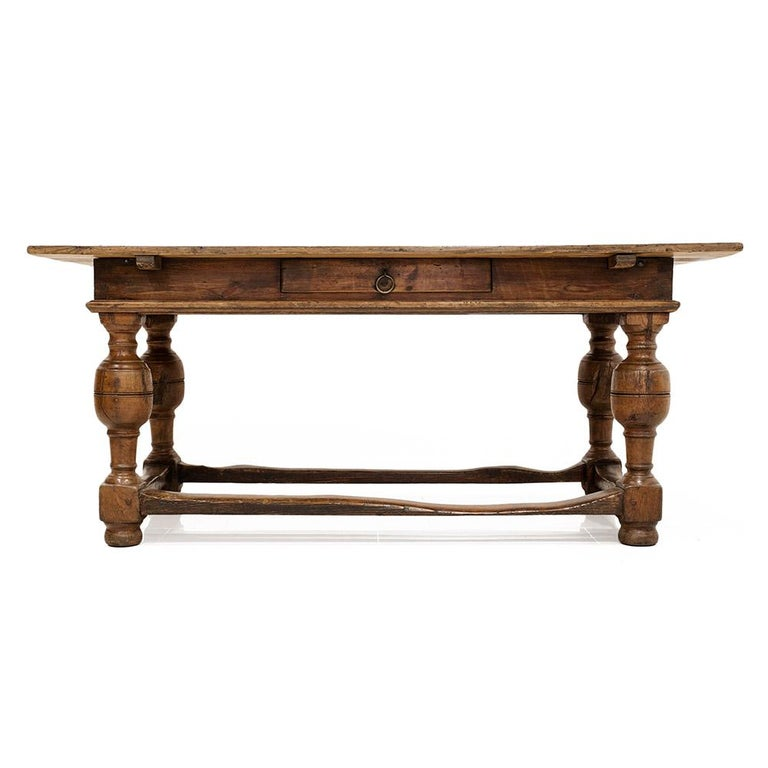 This gorgeous antique table was probably made circa 1770-1800. The tabletop is made of pine wood and base is made of ash and pine wood. One drawer resides in the table's apron that allows for storage. Five-wide pine boards comprise the table's top.