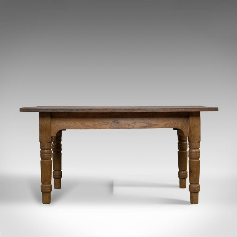 This is an antique dining table. An English, oak, kitchen table that seats four to six and dating to the late 19th century, circa 1900.  Good color, displaying grain interest with a desirable aged patina Mid-sized offering timeless appeal with