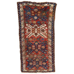 Antique Distressed Aigle Kazak Rug