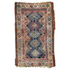 Antique Distressed Caucasian Kazak Rug