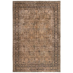 Antique Doroksh Brown and Blue Wool Rug with All-Over Floral Pattern