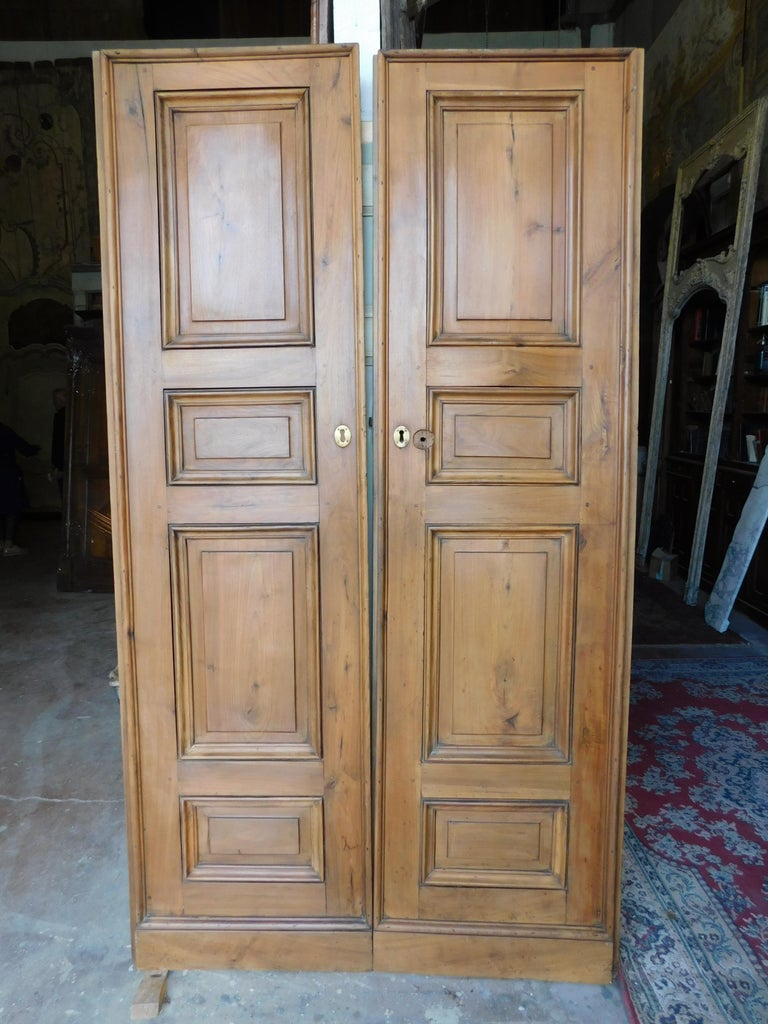 Antique double doors in walnut with carved panels, 1 pairs, built for an ancient convent of the 1700 in Italy. Beautiful patina, refined and elegant doors, of precious wood, suitable for all types of environments. Give value and luxury to your