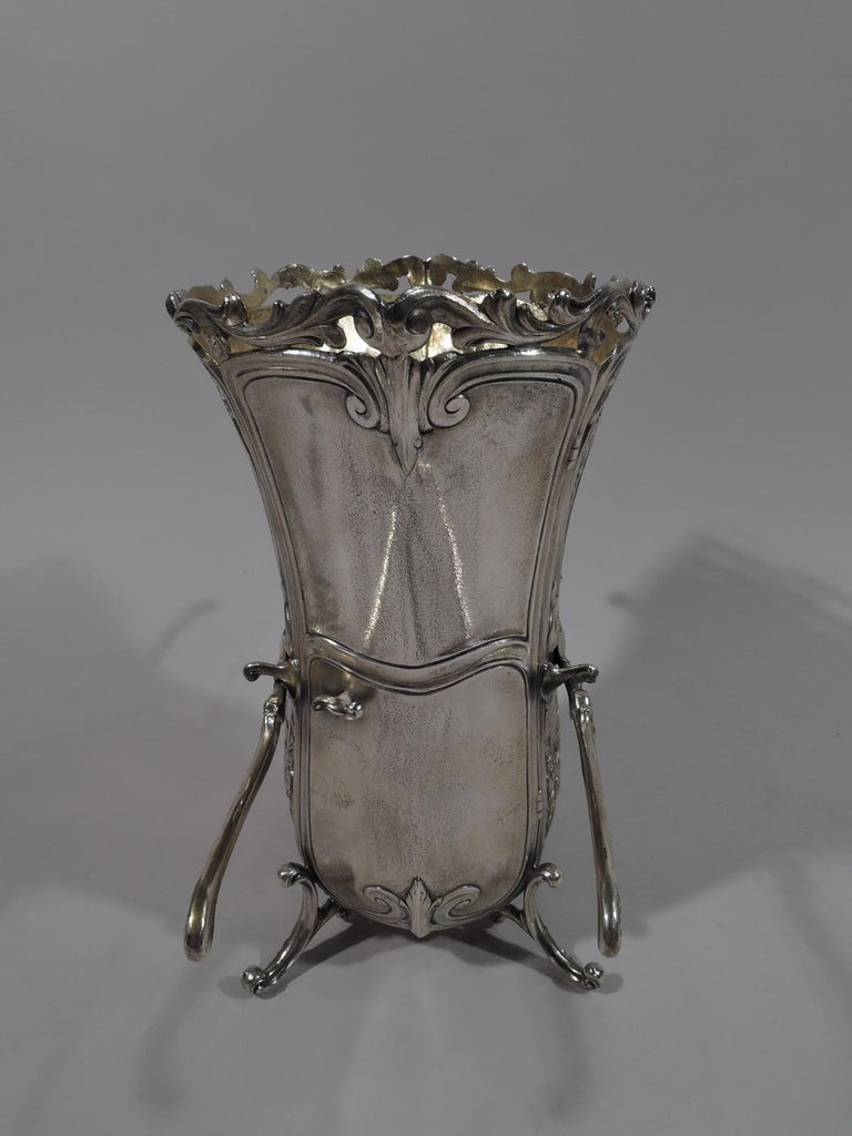 Rococo Revival sterling silver sedan chair vase. Made by Durgin (part of Gorham) in Providence in 1931. Deep and ovalish with applied open scrolled rim. Chased flowers and oval rondels inset with heads of olden-days belles in scrolled frames with