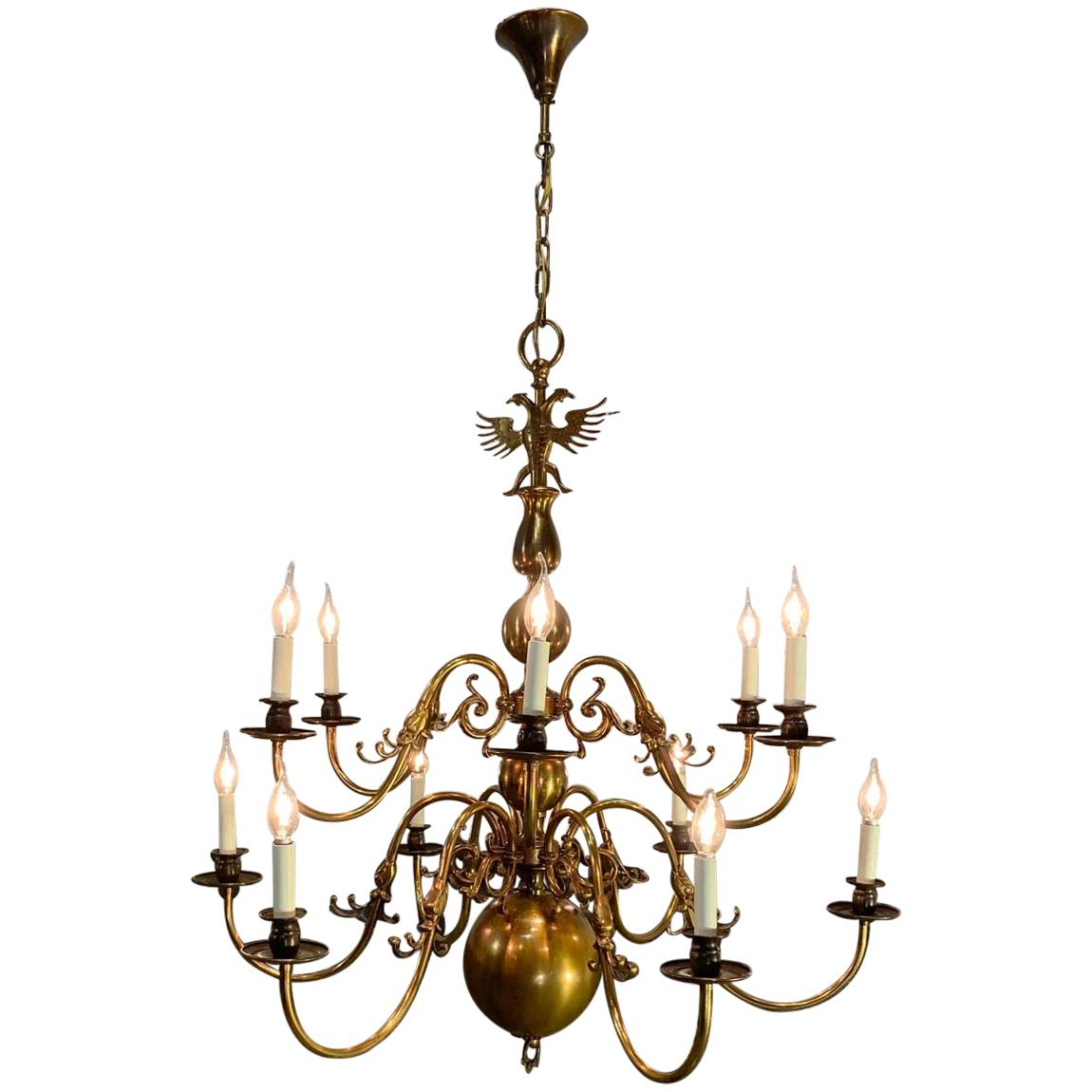 Antique Dutch Brass Two-Tier Twelve-Light Bulbous and Scrolled Chandelier