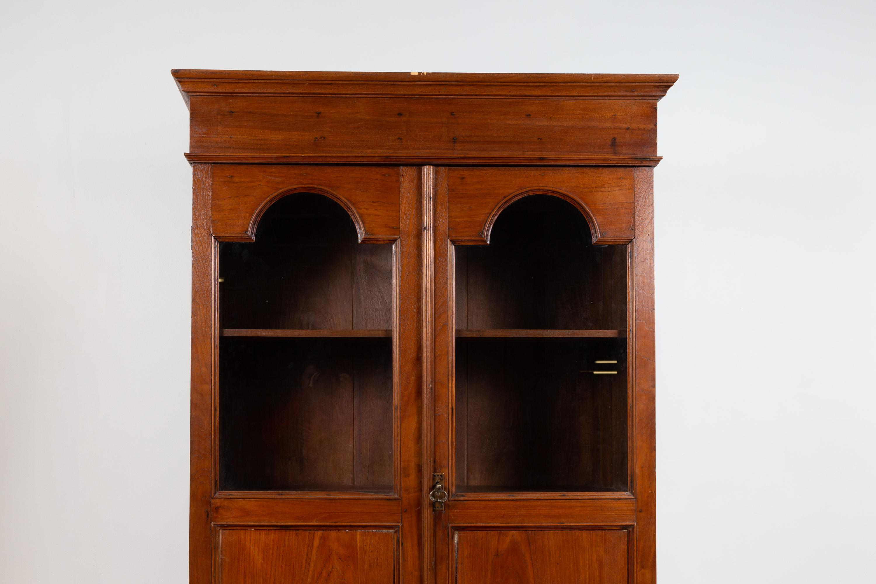 Antique Dutch Colonial Tall China Cabinet With Glass Doors And Arched Motifs