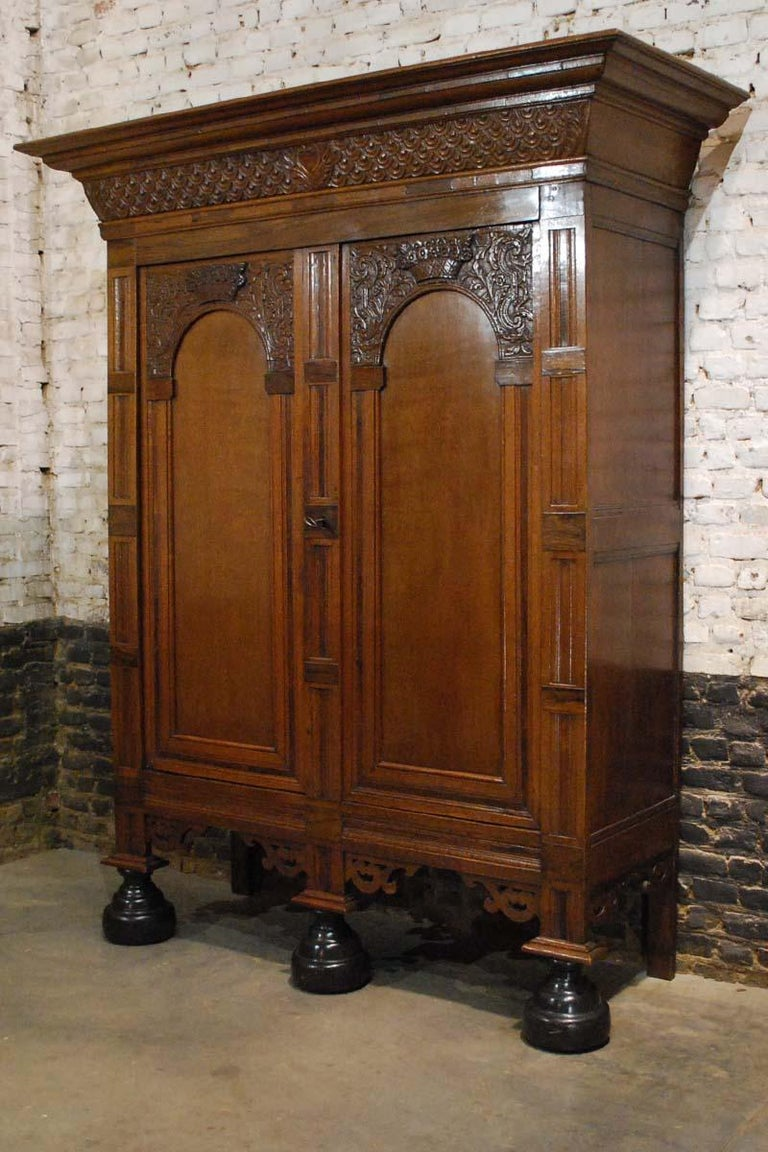 "This extraordinary cabinet is made of the finest oak in the tradition of the Dutch Renaissance during the ""Dutch golden age"" This cabinet is made in the Provence of Utrecht circa 1710. The arched doors are typical for this province and this type of"