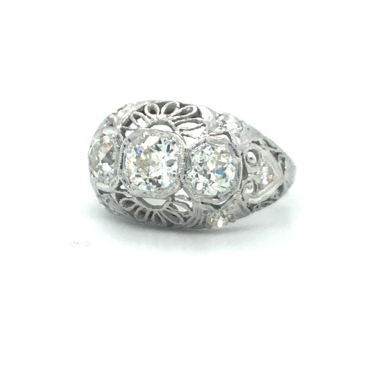 Antique Early 1900's Old Cut Diamond Three Stone Filigree Ring Platinum  Condition:  Excellent Condition, Professionally Cleaned and Polished Metal:  Platinum (Marked, and Professionally Tested) Diamonds:  Three Old Cut Diamonds 1.25ctw Diamond