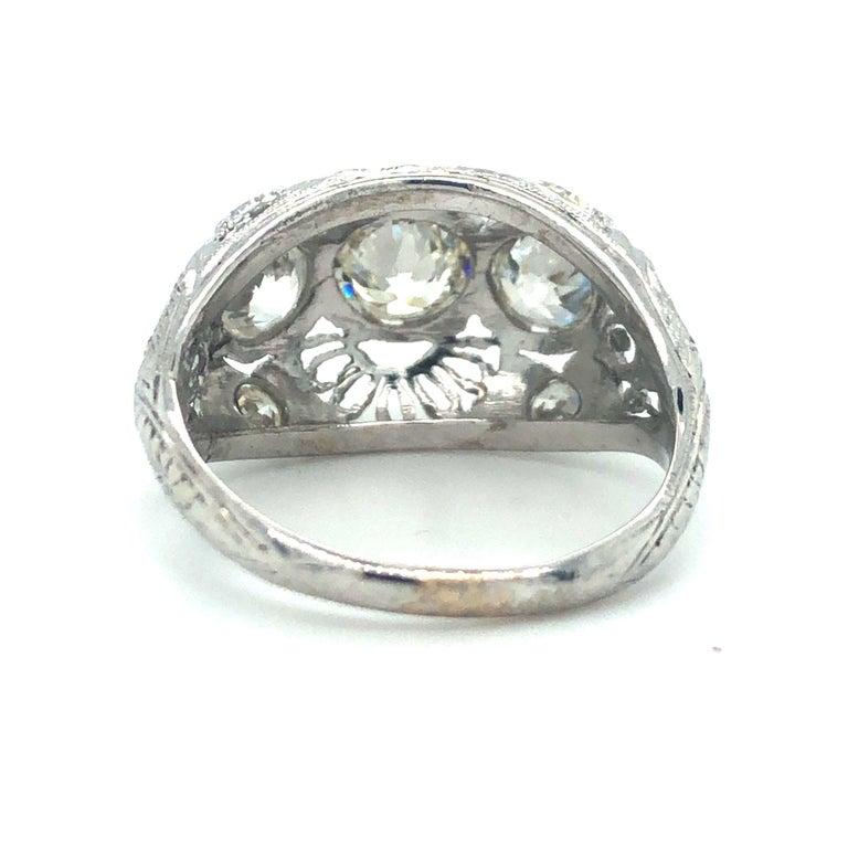 Women's Antique Early 1900s Old Cut Diamond Three-Stone Filigree Ring Platinum