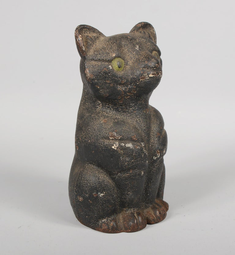 Cast iron black cat door stop. This cat retains the original paint with great crazing and lots of patina.