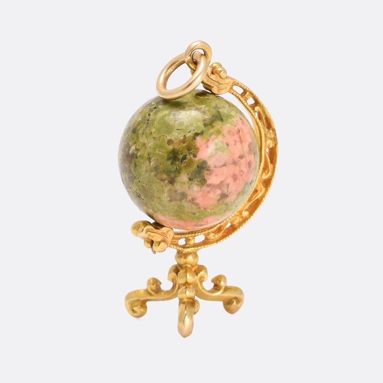 A cool and unusual antique globe pendant dating from the mid-19th Century. The Earth is represented by a sphere of green and pink unakite jasper, cleverly selected to that the pink parts look like the landmasses, and the green parts the oceans. The
