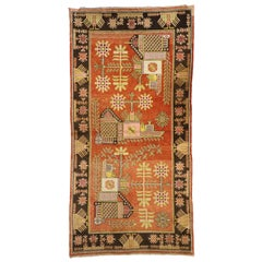 Antique Eastern Turkestan Pictorial Khotan Rug with Eclectic Northwestern Style