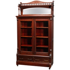 Antique Eastlake Carved Walnut Mirrored Two-Door Bookcase, circa 1890