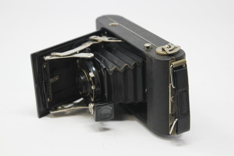 Collectible antique 1920s Kodak film camera in hard leather case.