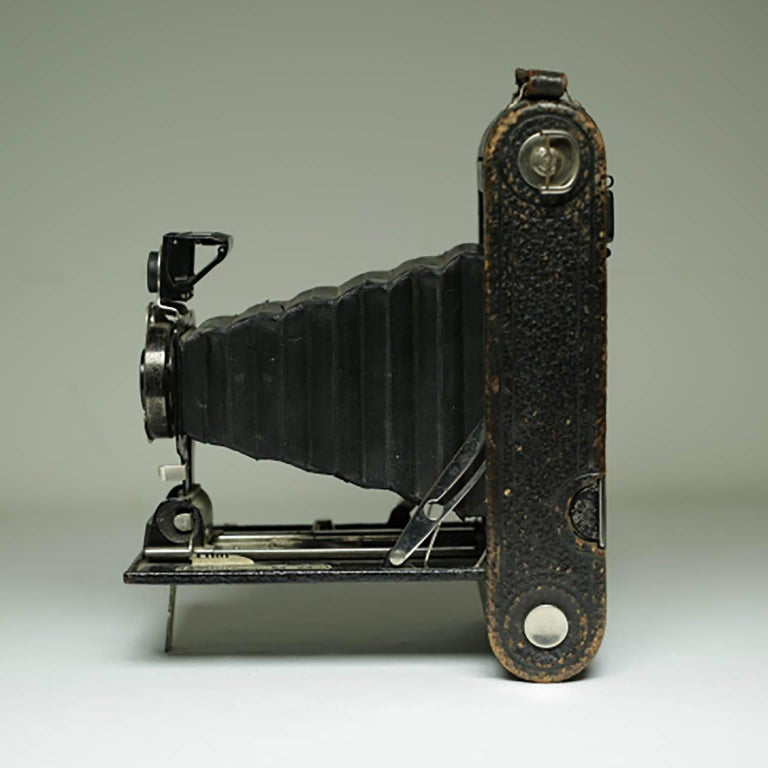 Leather wrapped fold out land camera. Fold flat into the case. May or may not work. Decorative only.