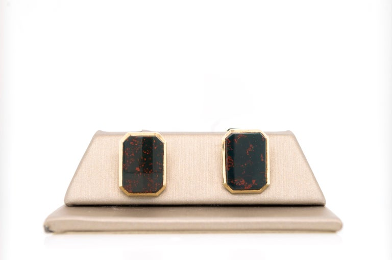 Edwardian 14k gold Bloodstone Agate cufflinks.  A lovely pair of rectangular form double-sided cufflinks composed of four well-matched, lively bloodstone agates, set within 14k gold frames. Circa 1900 Stamp: 14K Dimensions: 11.60mm x 15.70