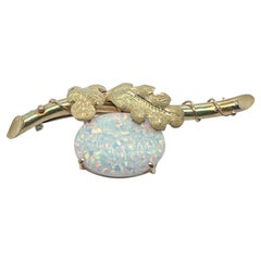Antique Edwardian 18 Karat Gold Brooch or Pin with a Large Opal Cabochon