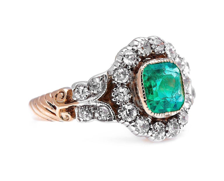 Emerald and diamond ring, early 20th century. With a beautiful octagonal step-cut emerald at its centre, this ring is an especially charming example of the 'garland style' which dominated jewellery design in the opening decade of the 20th century.
