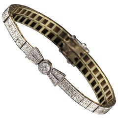 Antique Edwardian 18 Karat Yellow Gold and Platinum Top Diamond Bow Bracelet