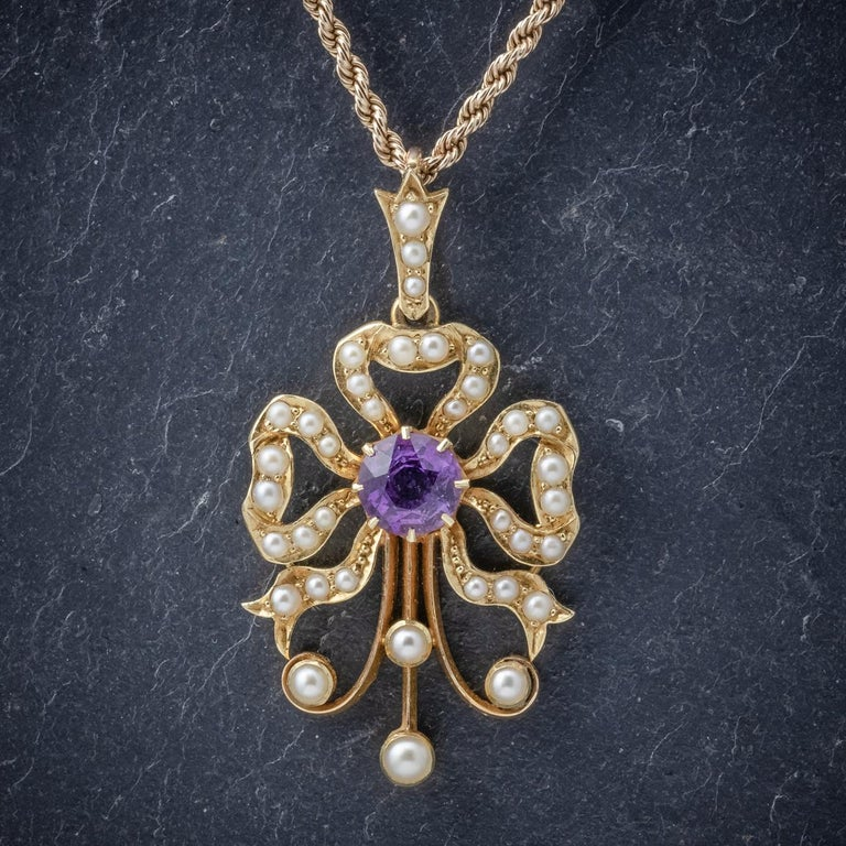 A lovely antique Edwardian necklace C. 1910 featuring a pretty pendant decorated with Pearls and a 0.70ct Amethyst. The pendant is a lovely unusual design and set in 15ct Yellow Gold. This is accompanied by a wonderful rope twist chain fitted with a