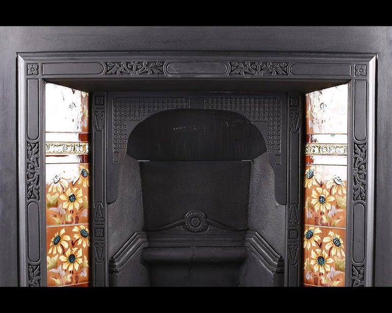 Antique Edwardian Art Nouveau Fireplace Insert Antique Edwardian Art Nouveau cast iron and tiled fireplace insert with repeating Art Nouveau design to the frame, circa 1905.  Stock No: RG1933