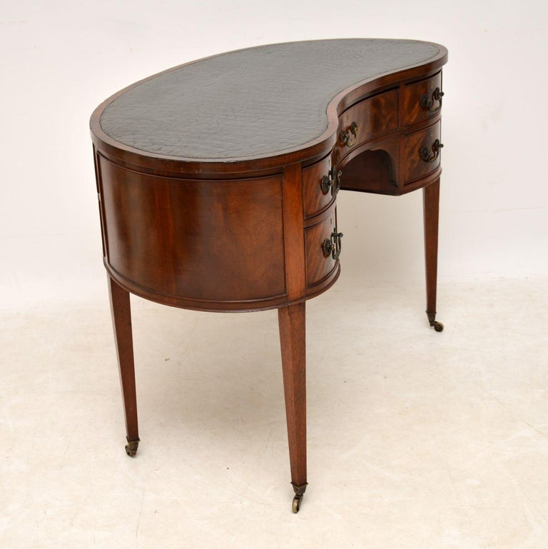 English Antique Edwardian Flame Mahogany Leather Top Desk For Sale