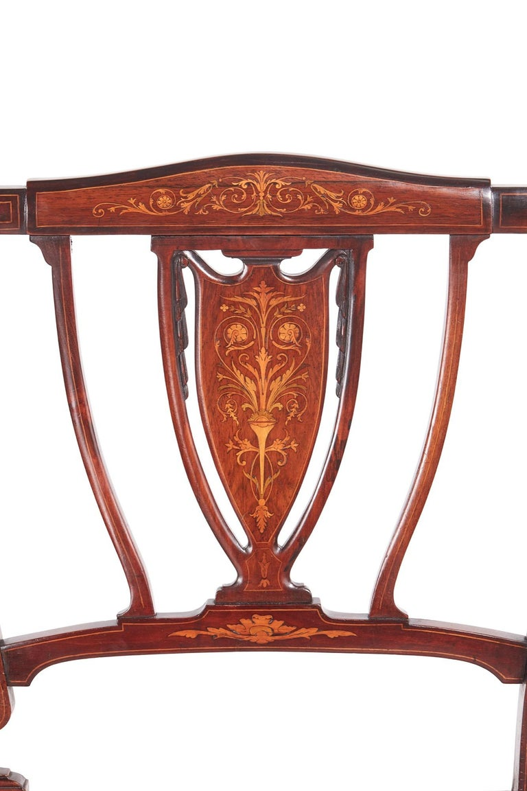 Antique Edwardian mahogany and rosewood inlaid settee sofa which has a lovely inlaid shaped top rail, lovely inlaid shaped splats, shaped open arms, newly recovered seat, standing on square tapering legs with spade feet to the front outswept back