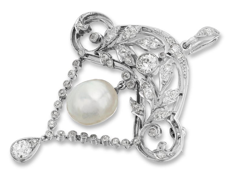 Alluring, Elegant, Edwardian Brooch/Pendant. Encrusted with diamonds and natural pearl centre set in 18 ct white gold.  1 x Natural Pearl with Gem & Pearl Laboratory Certificate, Dimension: 9.0 x 10.6 mm 51 x Old European Cut diamonds approximate