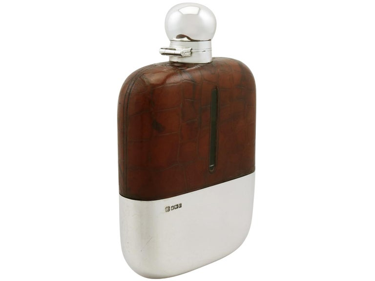 An exceptional, fine and impressive, large antique Edwardian glass, English sterling silver and crocodile skin mounted hip flask; an addition to our silver mounted glass collection  This exceptional antique Edwardian sterling silver hip flask has a