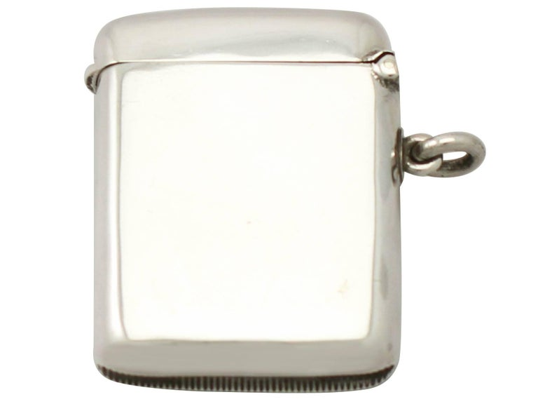 A fine and impressive antique Edwardian English sterling silver and enamel vesta case; an addition to our enamel and silver collection  This fine antique sterling silver vesta case has a plain rectangular rounded form.  The anterior surface is