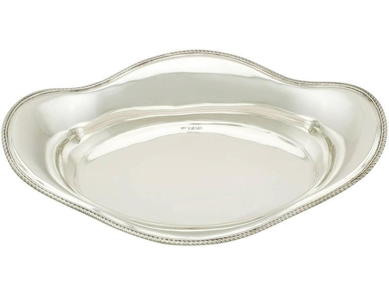 A fine and impressive antique Edwardian English sterling silver bread dish; an addition to our dining silverware collection.