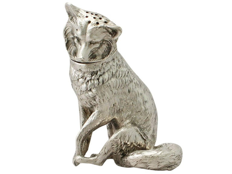 An exceptional, fine and impressive, large antique Edwardian English cast sterling silver pepper shaker in the form of a fox; an addition to our animal related silverware collection.