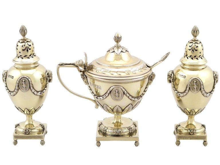 An exceptional, fine and impressive antique Edwardian English sterling silver gilt three piece condiment/cruet set - boxed; an addition to our dining silverware collection.  This exceptional antique Edwardian English sterling silver condiment set