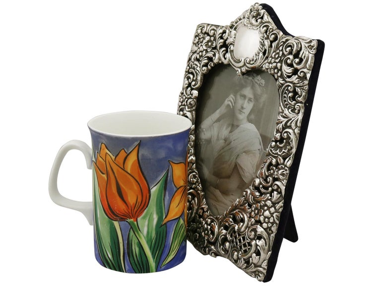 An exceptional, fine and impressive antique Edwardian English sterling silver photograph frame; an addition to our ornamental silverware collection.  This exceptional antique Edwardian sterling silver photo frame has a rectangular shaped form with