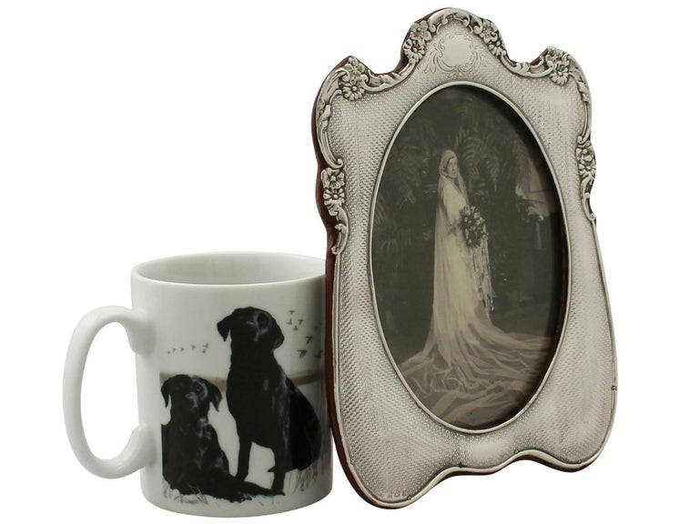 A fine and impressive antique Edwardian English sterling silver photograph frame; an addition to our diverse ornamental collection