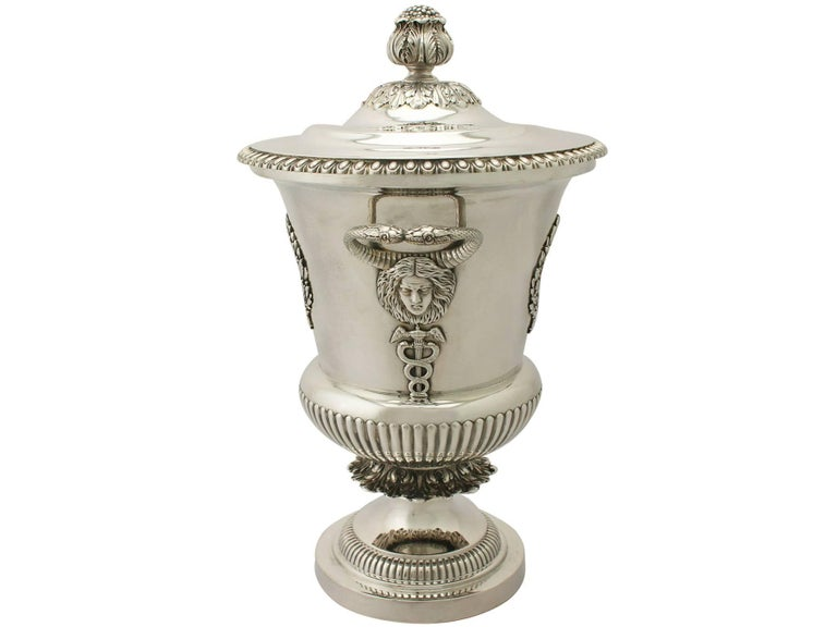 An exceptional, fine and impressive antique Edwardian English sterling silver cup & cover; an addition to our antique presentation silverware collection.  This exceptional antique Edwardian sterling silver presentation cup & cover has a campania